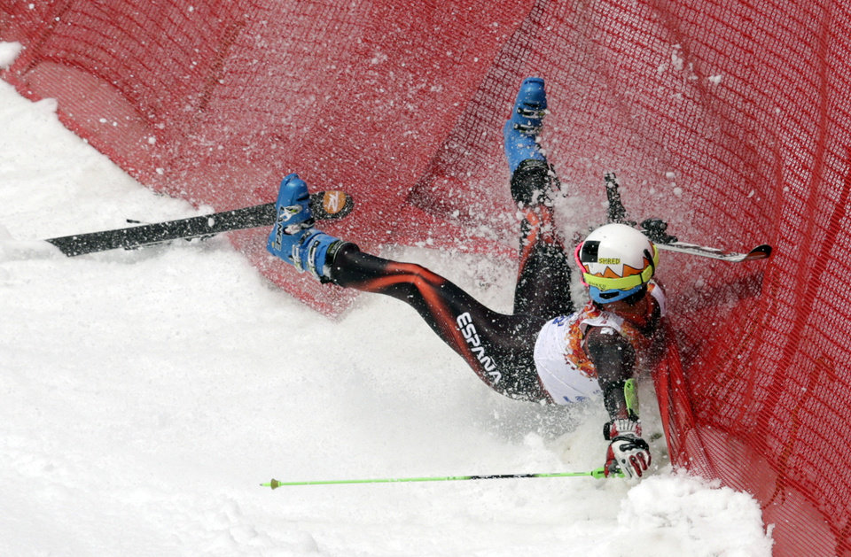Photo - Spain's Alex Puente Tasias crashes during  the first run of the men's giant slalom the Sochi 2014 Winter Olympics, Wednesday, Feb. 19, 2014, in Krasnaya Polyana, Russia. (AP Photo/Charles Krupa)