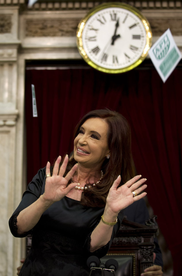 Argentina's President Cristina Fernandez acknowledges supporters after entering the chamber of the Argentine National Congress in Buenos Aires, Argentina, Friday, March 1, 2013. Fernandez was on hand to inaugurate the 2013 legislative year. (AP Photo/Victor R. Caivano)
