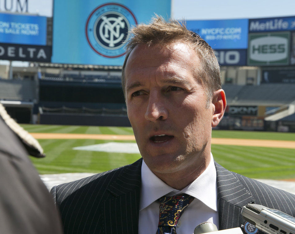 Photo - New York City Football Club soccer head coach Jason Kreis, answers questions on the field at New York's Yankee Stadium,  Monday, April 21, 2014.  The Yankees announced that Yankee Stadium will serve as the Club's first home and begin play on March 2015. (AP Photo/Richard Drew)