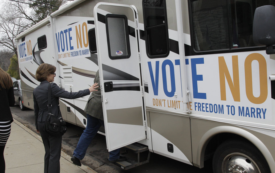 "State Auditor Rebecca Otto enters the RV at a stop in Edina, Minn., on the ""Minnesota Votes No"" statewide tour Monday, Nov. 5, 2012 in Minneapolis for the final day of the campaign to urge voters to vote against the marriage amendment. Candidates and volunteers worked Monday to make the most of their last 24 hours before decision day, hustling to energize their core supporters and searching for any remaining fence-sitters. Meanwhile, both political parties said they were gearing up like never before to watch the other for any electioneering on Tuesday. (AP Photo/Jim Mone)"