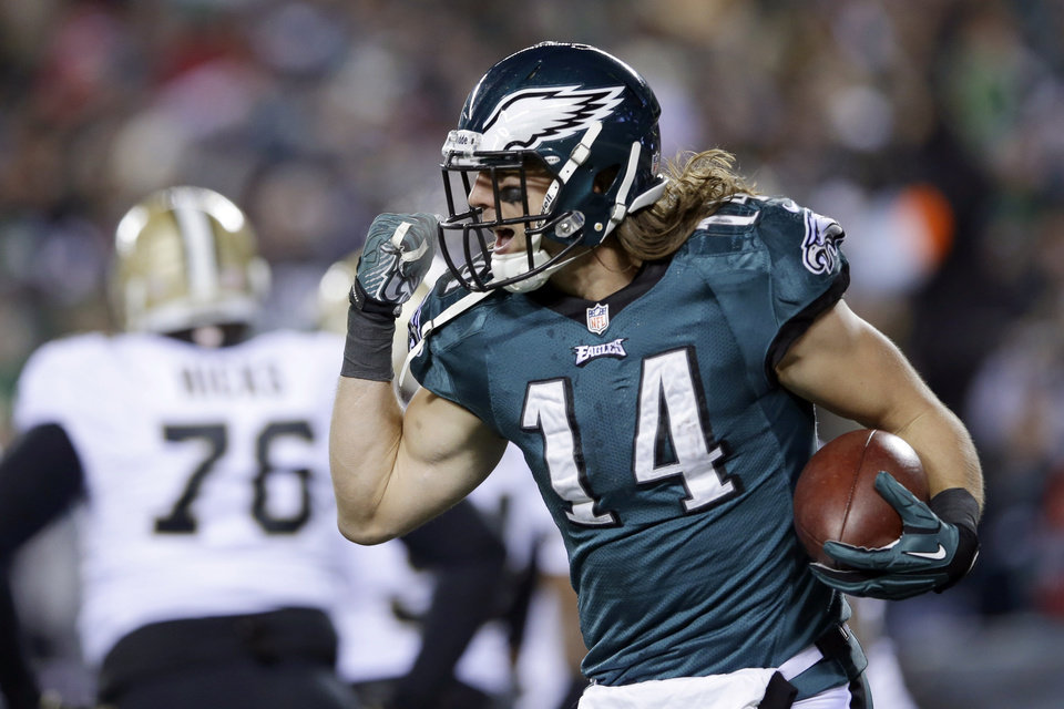 Photo - Philadelphia Eagles' Riley Cooper celebrates after scoring a touchdown during the first half of an NFL wild-card playoff football game against the New Orleans Saints, Saturday, Jan. 4, 2014, in Philadelphia. (AP Photo/Michael Perez)