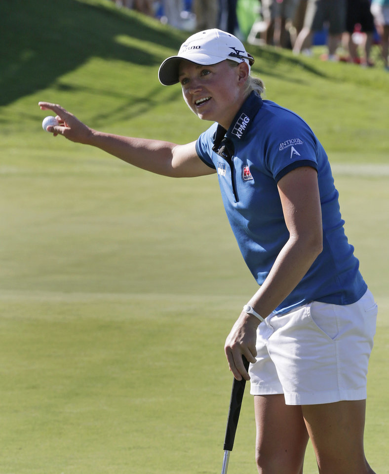 Photo -   Stacy Lewis reacts after winning the Navistar LPGA Classic golf tournament on Sunday, Sept. 23, 2012, at the Robert Trent Jones Golf Trail in Prattville, Ala. (AP Photo/Dave Martin)