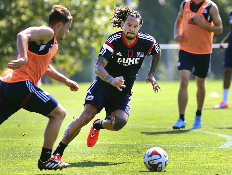 Photo - New England Revolution's newest player Jermaine Jones, center, chases the ball during a soccer training session Tuesday, Aug. 26, 2014, in Foxborough, Mass. (AP Photo/The Boston Globe, John Tlumacki)  BOSTON HERALD OUT, QUINCY OUT; NO SALES