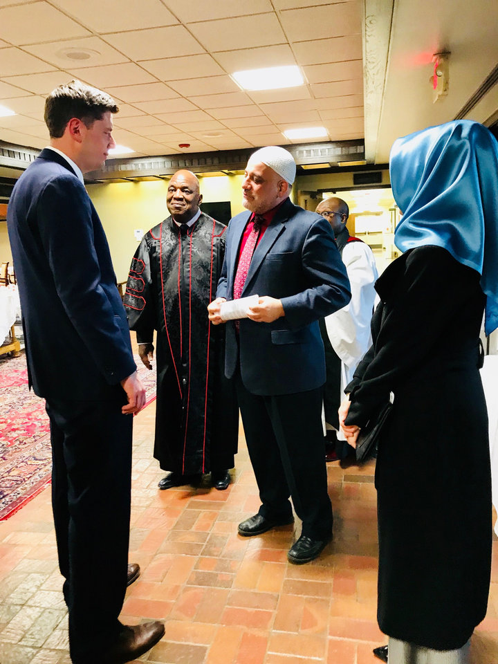 Photo - Oklahoma City Mayor-elect David Holt speaks to several religious leaders including the Rev. Major Jemison, Imam Imad Enchassi and Kuaybe Basturk, executive director of the Dialogue Institute, after