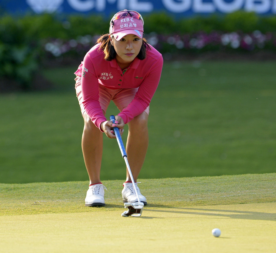 Photo - Hee Young Park of South Korea lines up a putt at the 18th hole in the second round of the Airbus LPGA Classic golf tournament at Magnolia Grove on Friday, May 23, 2014, in Mobile, Ala. (AP Photo/G.M. Andrews)