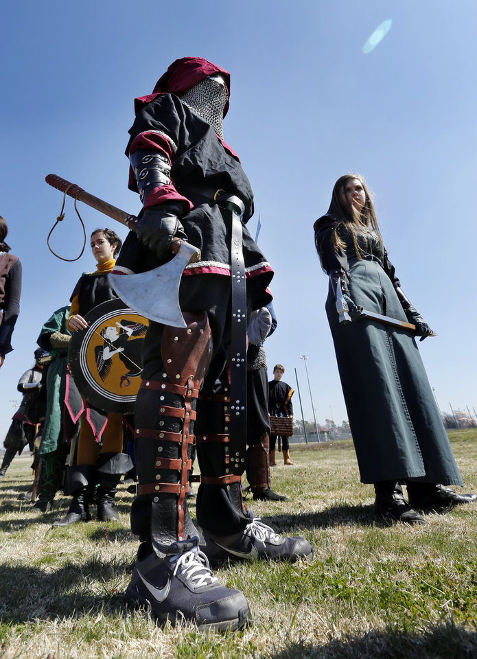 Photo -  Seth Slimp lines up for a processional during a Medieval Fair rehearsal in Reaves Park. The fair opens Friday and continues through Sunday at the park. PHOTO BY STEVE SISNEY, THE OKLAHOMAN   STEVE SISNEY -