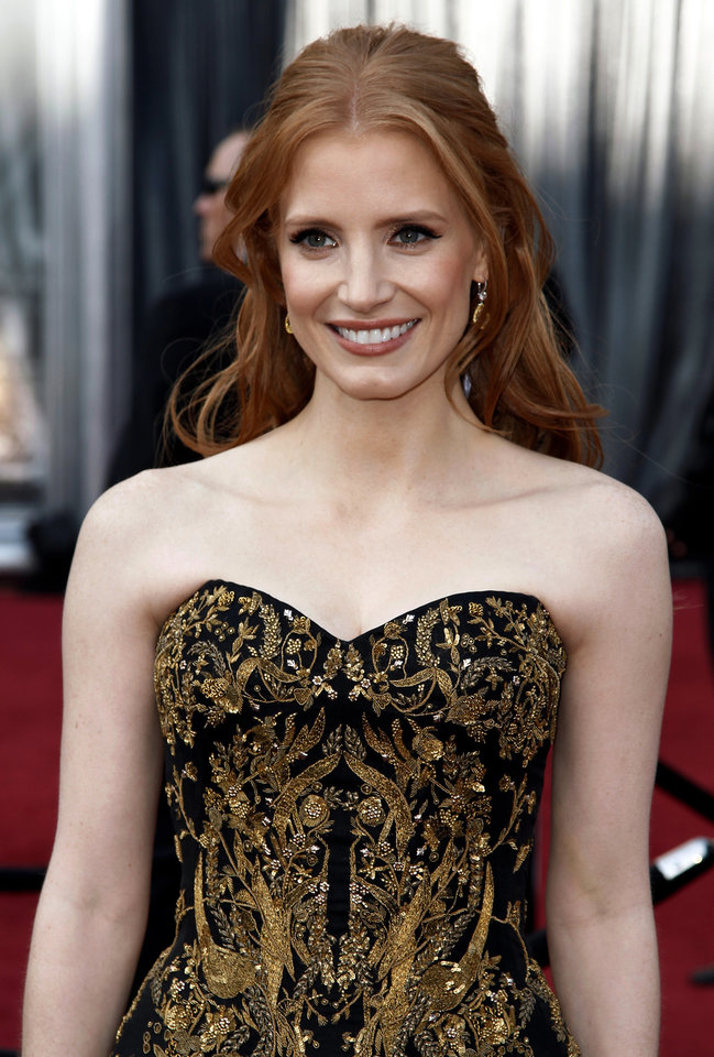 Jessica Chastain arrives before the 84th Academy Awards on Sunday, Feb. 26, 2012, in the Hollywood section of Los Angeles. (AP Photo/Matt Sayles) ORG XMIT: OSC121