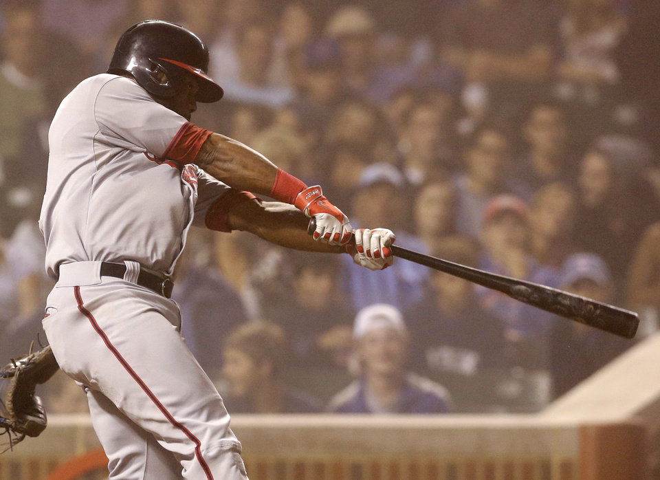 Photo - Washington Nationals' Denard Span hits a two-run double against the Chicago Cubs during the seventh inning of a baseball game in Chicago, Thursday, June 26, 2014. (AP Photo/Nam Y. Huh)
