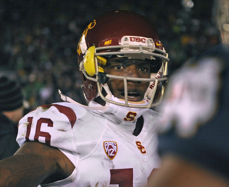"Photo - FILE - In this Oct. 19, 2013, file photo, Southern California cornerback Anthony Brown shakes hands with a Notre Dame player following an NCAA football game in South Bend, Ind. Anthony Brown has quit Southern California's football team, and coach Steve Sarkisian was stunned by Brown's apparent accusations of racism against him on social media. ""Couldn't play for a racist man!"" was posted Thursday, Aug. 28, 2014 on what USC said was Brown's Instagram account, which was later deleted. Sarkisian calls the apparent accusation ""ridiculous."" Several players immediately jumped on social media to defend the first-year USC coach. (AP Photo/Joe Raymond, File)"