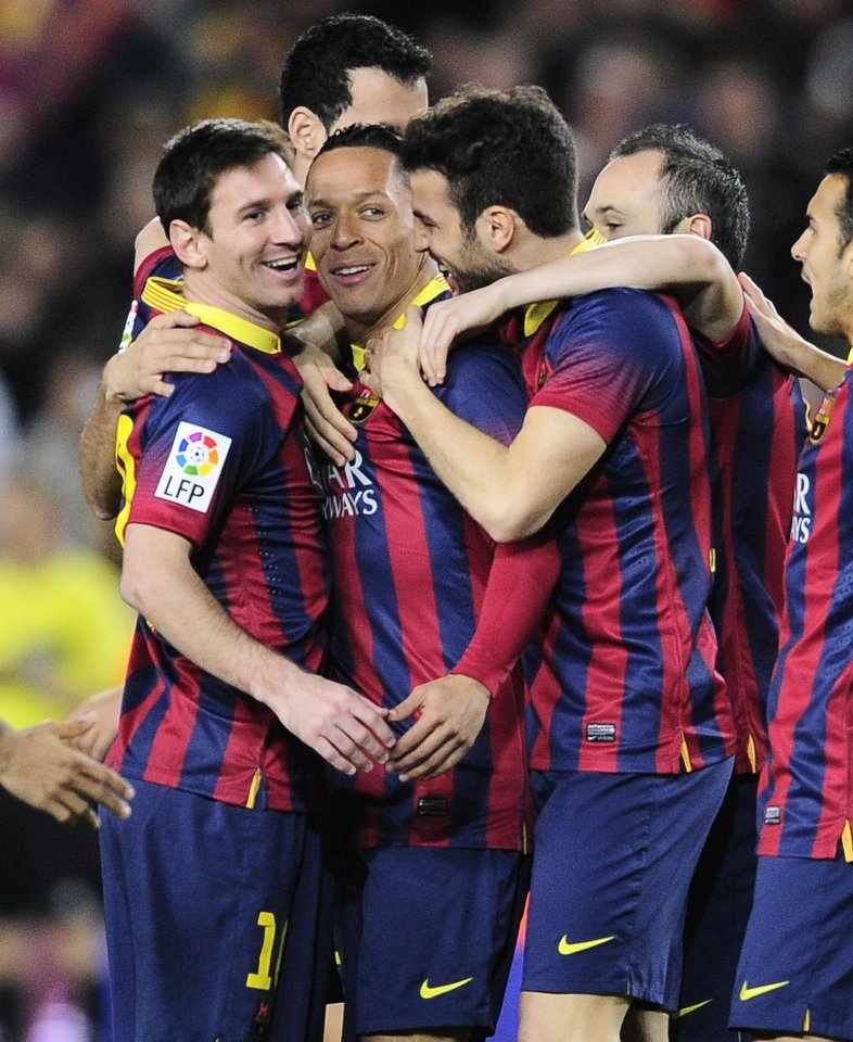 Photo - FC Barcelona's Adriano, from Brazil, second left, reacts after scoring with his teammates Lionel Messi, from Artentina, left, and Cesc Fabregas, third left, against Rayo Vallecano during a Spanish La Liga soccer match at the Camp Nou stadium in Barcelona, Spain, Saturday, Feb. 15, 2014. (AP Photo/Manu Fernandez)