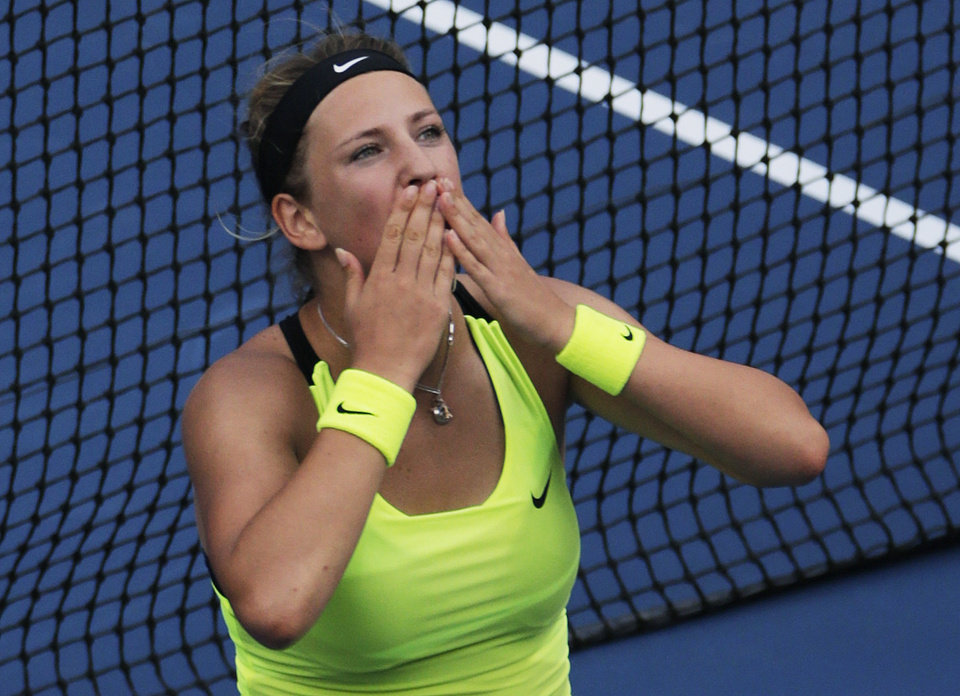 Photo -   Victoria Azarenka, of Belarus, blows kisses to the crowd after her match against Maria Sharapova, of Russia, during a semifinal match at the 2012 US Open tennis tournament, Friday, Sept. 7, 2012, in New York. Coming all the way back from a set and a break down, the top-seeded Azarenka prevailed in a stirring third, beating four-time major champion Sharapova 3-6, 6-2, 6-4 to reach her first U.S. Open final. (AP Photo/Charles Krupa)