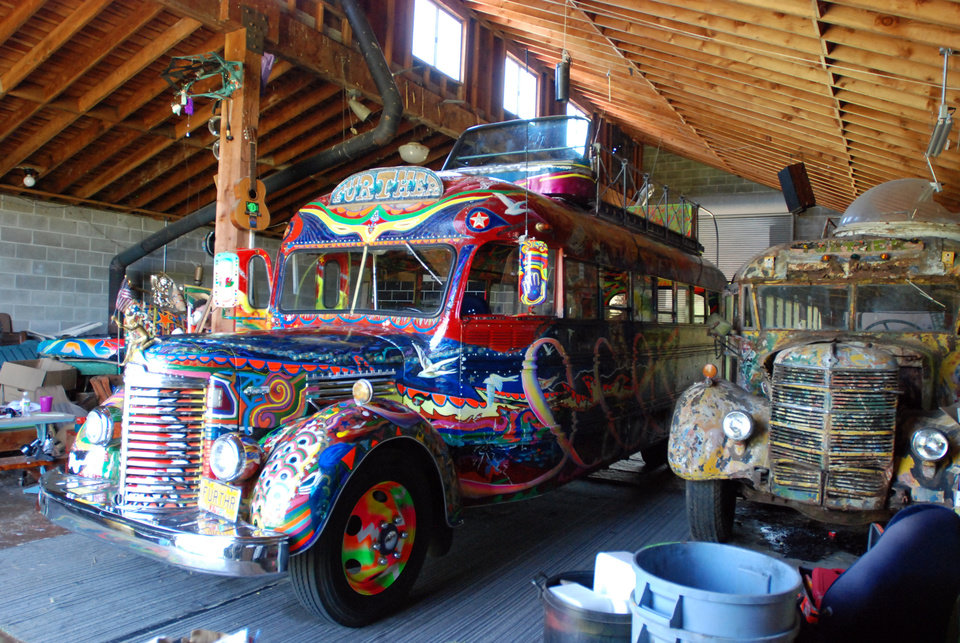 Photo - The original 1939 International bus dubbed Further and ridden on a cross-country trip in 1964 by author Ken Kesey and his friends, the Merry Pranksters, right, sits in a barn in Pleasant Hill, Ore., on May 14, 2014. Next to it, left, is a newer version of the bus that Kesey's son, Zane, plans to put back on the road for a 50th anniversary commemoration of the trip that became an icon of the psychedelic 1960s. (AP Photo/Jeff Barnard)