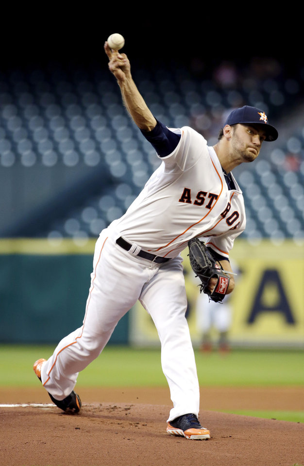 Photo - Houston Astros starting pitcher Jarred Cosart throws against the Washington Nationals during the first inning of a baseball game Tuesday, April 29, 2014, in Houston. (AP Photo/David J. Phillip)