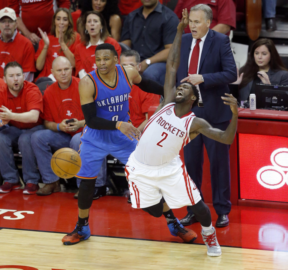 Photo - Oklahoma City's Russell Westbrook (0) fouls Houston's Patrick Beverley (2) during Game 5 in the first round of the NBA playoffs between the Oklahoma City Thunder and the Houston Rockets in Houston, Texas,  Tuesday, April 25, 2017.  Photo by Sarah Phipps, The Oklahoman