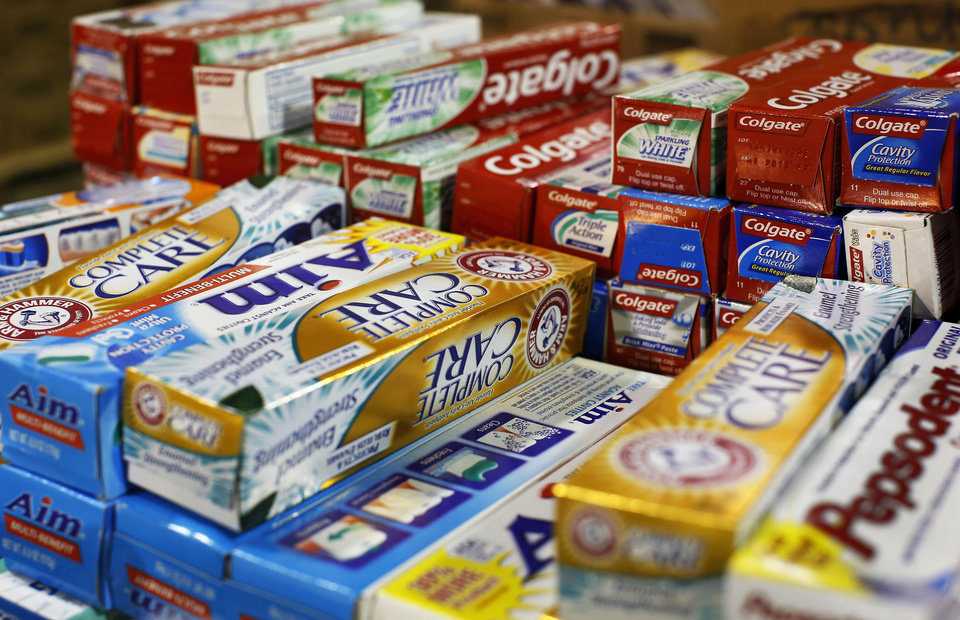 Photo - A large selection of toothpastes are spread across one of the tables as part of the
