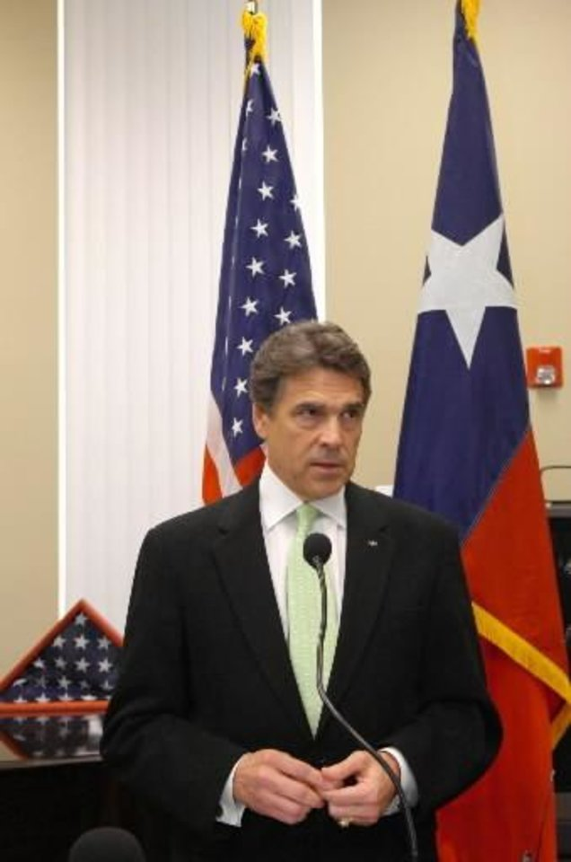 Photo - Texas Gov. Rick Perry speaks to media about the shootings on a U.S. Army base at  Fort  Hood, Texas which killed 12 and wounded 31 people, Thursday, Nov. 5, 2009 at the University of North Texas in Denton. (AP Photo/Denton Record-Chronicle, David Minton)