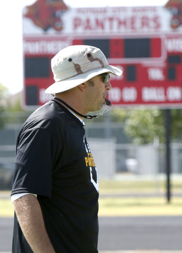 Photo - Head Coach Rod Richardson watches his team during morning practice at Putnam City North High School in Oklahoma City, OK, Monday, August 18, 2014,  Photo by Paul Hellstern, The Oklahoman