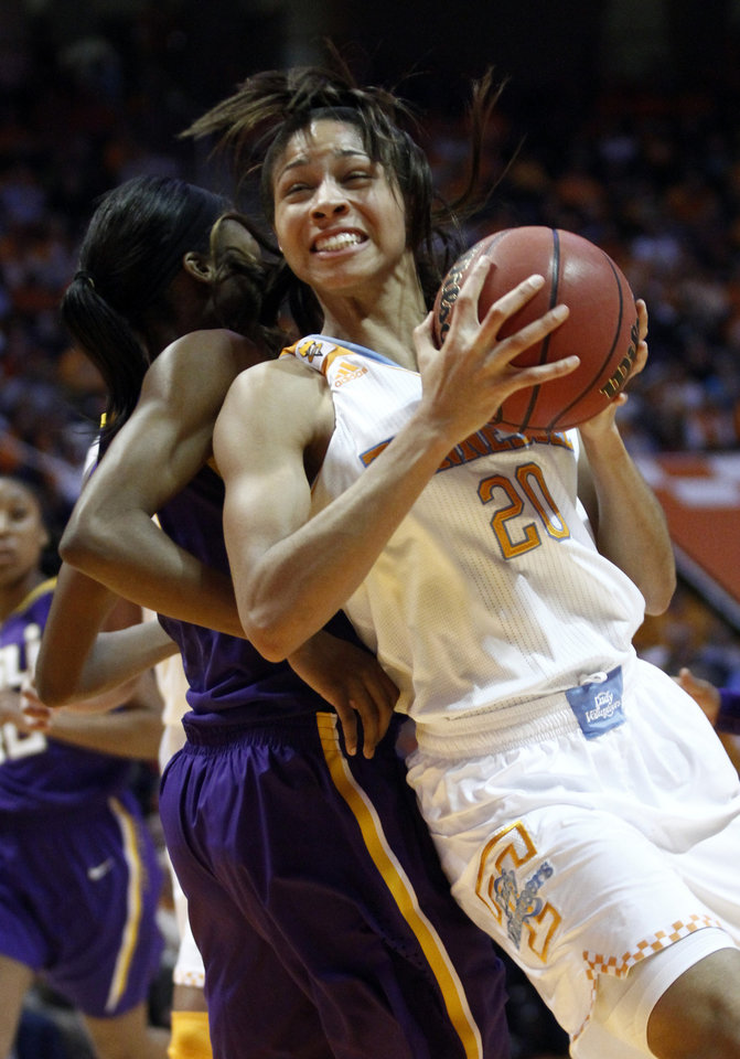 Photo - Tennessee center Isabelle Harrison (20) goes for a shot as she's defended by LSU forward Sheila Boykin (42) during the first half of an NCAA college basketball game Thursday, Jan. 2, 2014, in Knoxville, Tenn. (AP Photo/Wade Payne)