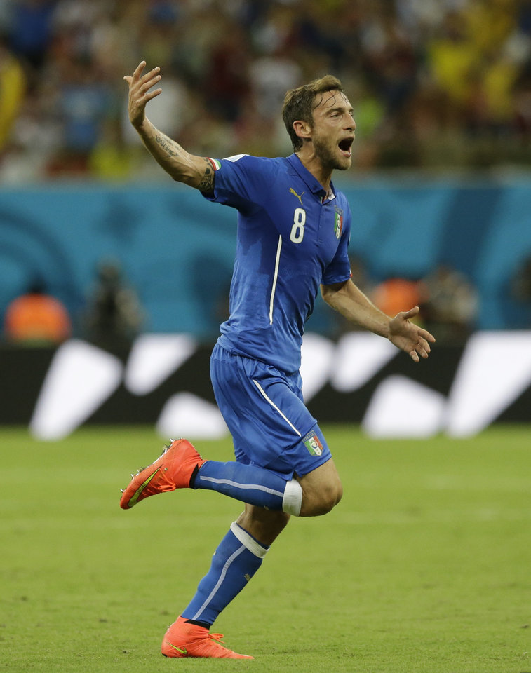Photo - FILE - In this June 14, 2014 file photo, Italy's Claudio Marchisio celebrates after scoring the opening goal during the group D World Cup soccer match with England at the Arena da Amazonia in Manaus, Brazil. Some players and coaches complained that it was too hot to play in Manaus. Marchisio said he felt like he was hallucinating during the match against England because it was so hot. (AP Photo/Matt Dunham, File)