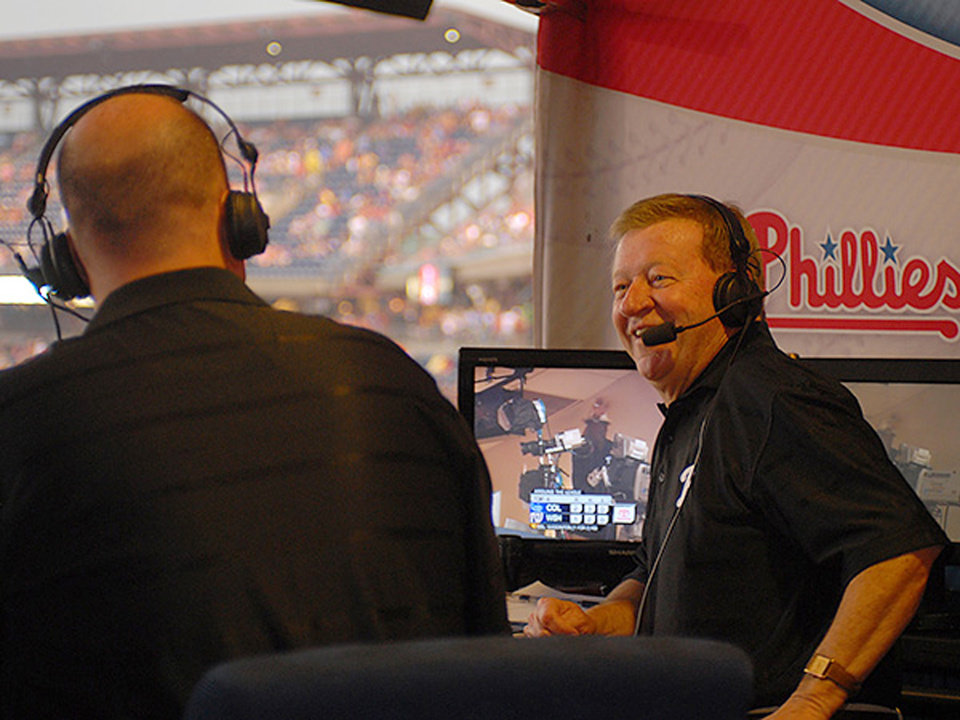 Photo - In this undated photo, Tom McCarthy, left, and Chris Wheeler talk in the broadcast booth at Citizens Bank Park in Philadelphia. Longtime Philadelphia Phillies broadcaster Chris Wheeler is out after nearly four decades in the booth and Gary Matthews isn't returning as color analyst. The team recently signed a new television contract with NBCUniversal and Comcast SportsNet that's reportedly worth $2.5 billion over 25 years. The decision to replace Wheeler and Matthews came from the network, multiple sources told The Associated Press on Wednesday, Jan. 8, 2014,  on condition of anonymity because it hadn't commented on the matter. (AP Photo/Philadelphia Daily News, Jarid Barringer)  THE EVENING BULLETIN OUT, TV OUT, MAGS OUT, NO SALES -