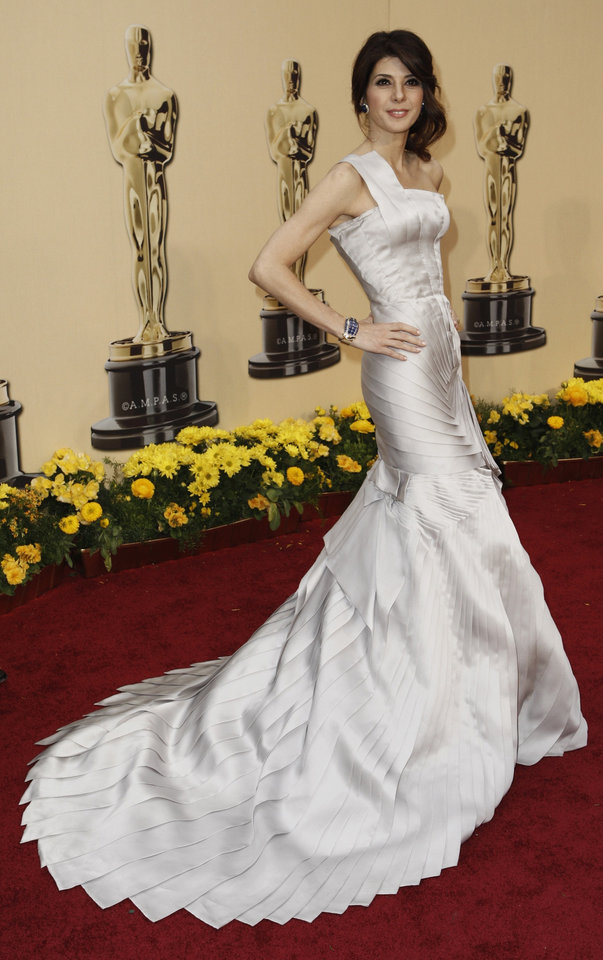 Photo - ** LINDA MILLER'S COMMENTARY:    My only complaint about this one-shoulder, layered gown was that I thought the bodice looked puckery.   ** Marisa Tomei, nominated for an Oscar for best actress in a supporting role for her work in