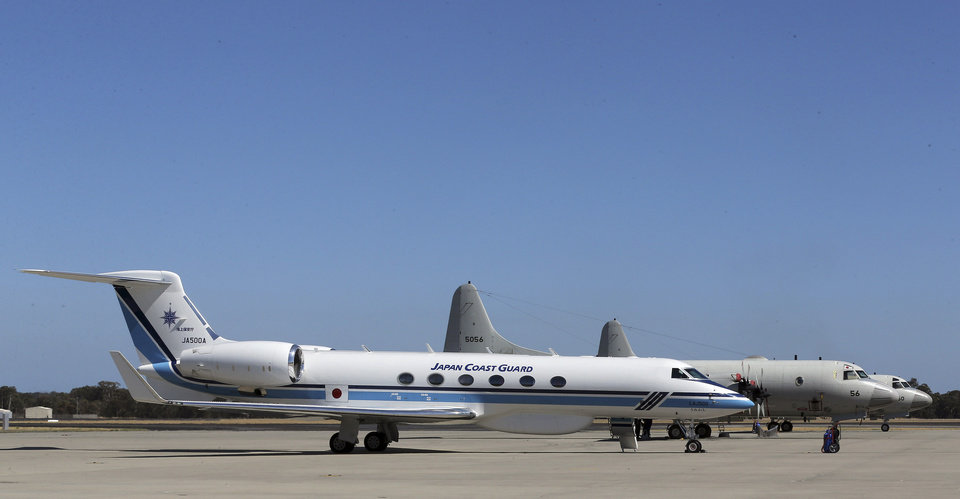 Photo - Japan Coast Guard's Gulfstream V, foreground, and two Japan Maritime Self-Defense Force's P-3 Orions sit on the tarmac at RAAF Base Peace in Perth, Australia, Wednesday, April 2, 2014. Ten planes and nine ships resume the search for the missing Malaysia Airlines flight MH370 in the southern Indian Ocean. (AP Photo/Rob Griffith)
