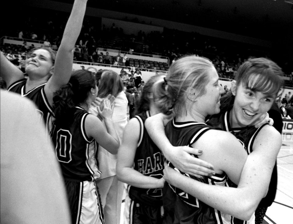 Photo -  Members of the Harvard women's basketball team celebrate after defeating Stanford 71-67 on March 14, 1998. [AP PHOTO]