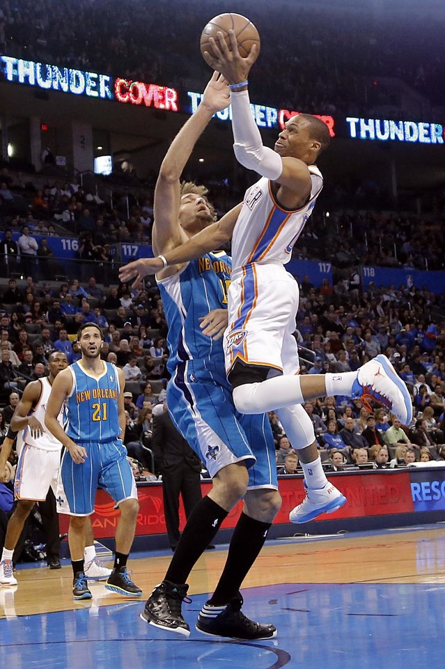 Oklahoma City Thunder\'s Russell Westbrook (0) drives past New Orleans Hornets\' Robin Lopez (15) during the NBA basketball game between the Oklahoma City Thunder and the New Orleans Hornets at the Chesapeake Energy Arena on Wednesday, Feb. 27, 2013, in Oklahoma City, Okla. Photo by Chris Landsberger, The Oklahoman