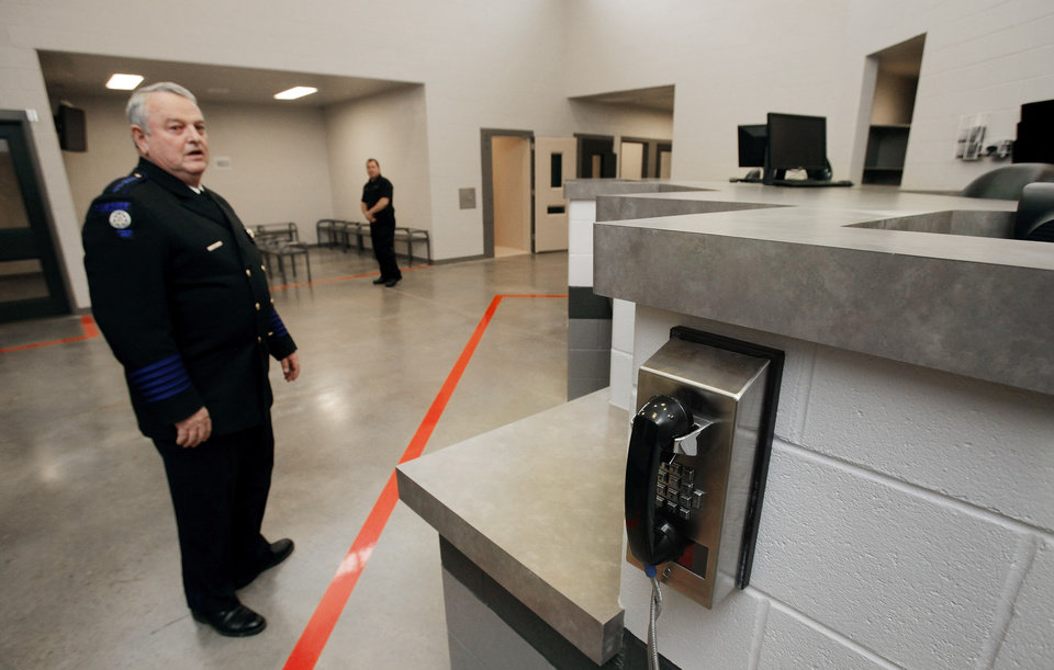 Cleveland County Sheriff Joe Lester gives a tour of the reception area of the new F. DeWayne Beggs Detention Center on Friday, Jan. 27, 2012, in Norman, Okla.   Photo by Steve Sisney, The Oklahoman