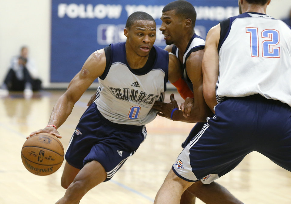 Photo - Oklahoma CIty's Russell Westbrook goes past Ronnie Price during the Thunder's annual Blue and White Scrimmage at John Marshall Mid-High School in Oklahoma City, Tuesday, Sept. 27, 2016. Photo by Bryan Terry, The Oklahoman