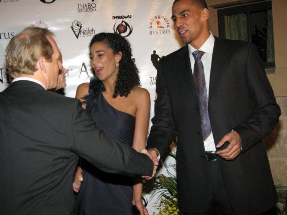 Photo - Bertille and Thabo Sefolosha, right, greet guests on the red carpet during their recent