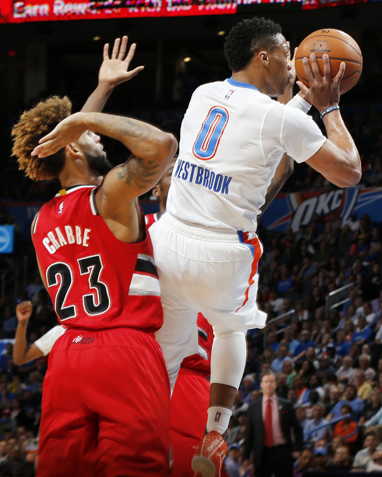 Photo - Oklahoma City's Russell Westbrook (0) shoots after being fouled by Portland's Allen Crabbe (23) during an NBA basketball game between the Oklahoma City Thunder and the Portland Trailblazers at the Chesapeake Energy Arena in Oklahoma City, Monday, March 14, 2016. Photo by Nate Billings, The Oklahoman
