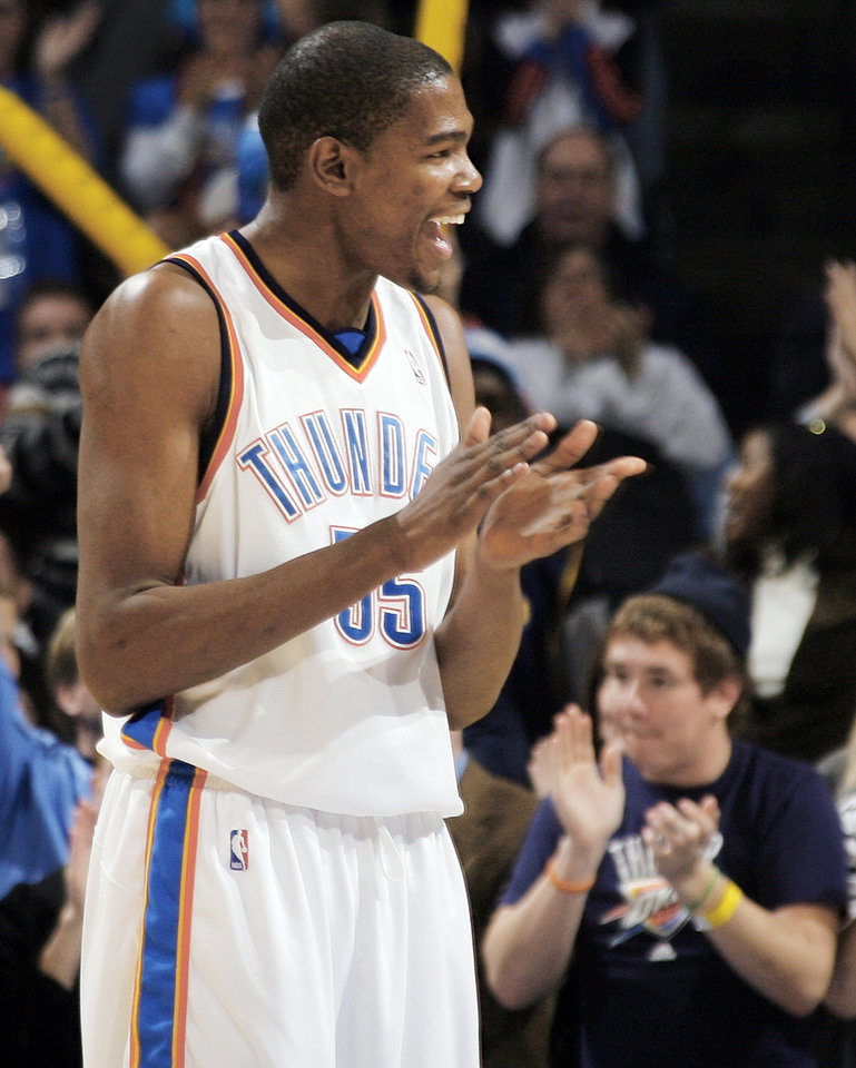 Photo - Thunder forward Kevin Durant claps after a basket by a teammate during Oklahoma City's 101-84 win over Denver on Jan. 29. PHOTO BY NATE BILLINGS, THE OKLAHOMAN