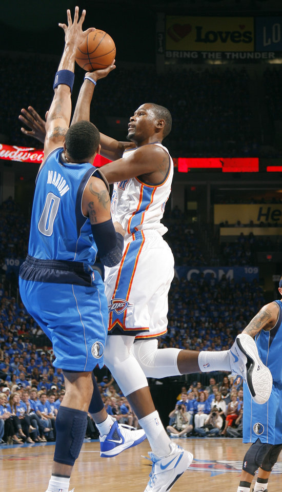 Oklahoma City\'s Kevin Durant (35) shoots as Dallas\' Shawn Marion (0) defends during game one of the first round in the NBA playoffs between the Oklahoma City Thunder and the Dallas Mavericks at Chesapeake Energy Arena in Oklahoma City, Saturday, April 28, 2012. Photo by Sarah Phipps, The Oklahoman