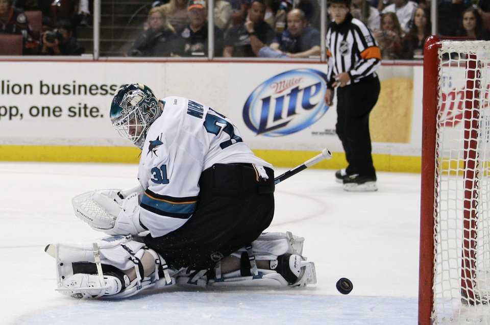Photo - A shot by Anaheim Ducks' Patrick Maroon enters the net past San Jose Sharks goalie Antti Niemi, of Finland, during the second period of an NHL hockey game on Wednesday, April 9, 2014, in Anaheim, Calif. (AP Photo/Jae C. Hong)