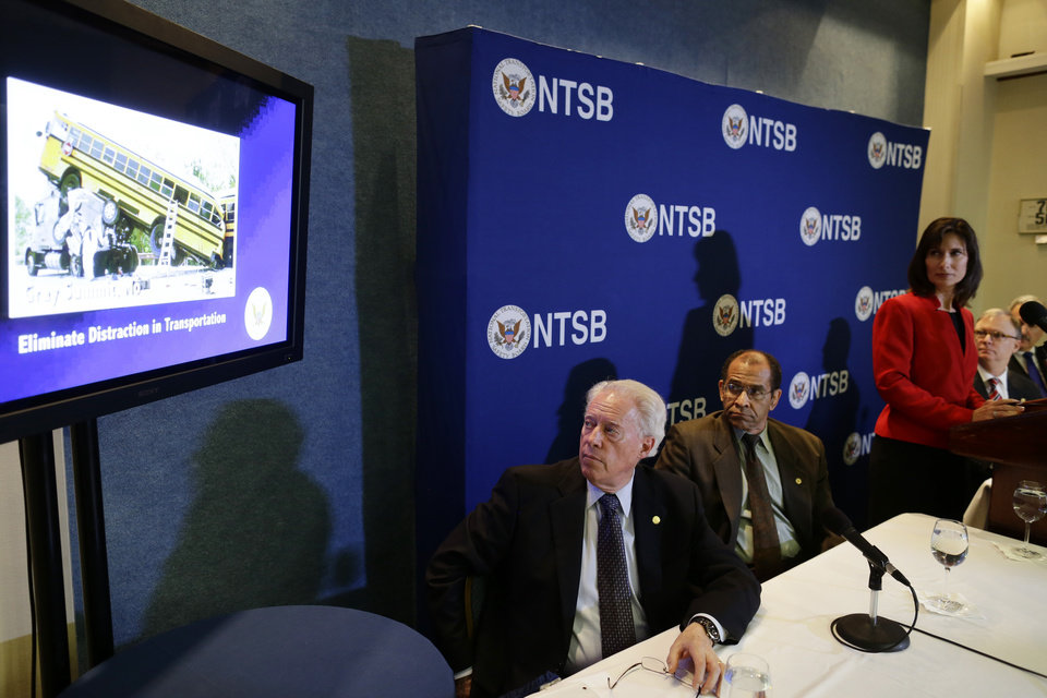 Photo -   National Transportation Safety Board (NTSB) Chair Deborah Hersman, third from right, along with board members, from left: Earl F. Weener; Christopher A. Hart; Robert L. Sumwalt; and Mark R. Rosekind watch a video a news conference regarding its 2013