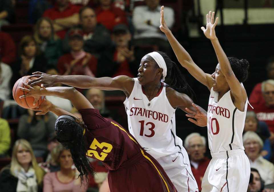 Photo - Stanford forward Chiney Ogwumike (13) blocks a shot attempt by Arizona State guard Elisha Davis (23) as guard Briana Roberson (10) helps defend during the first half of an NCAA college basketball game on Friday, Feb. 14, 2014, in Stanford, Calif. (AP Photo/Marcio Jose Sanchez)