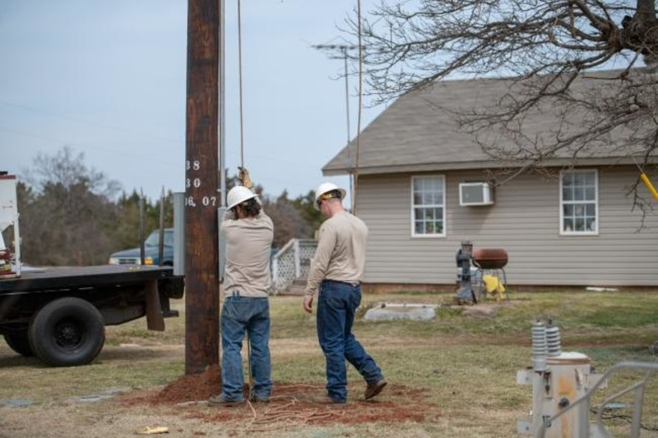 Photo -  Central Electric Cooperative crew members extend service to a new customer in its territory. [PROVIDED BY CENTRAL ELECTRIC COOPERATIVE]