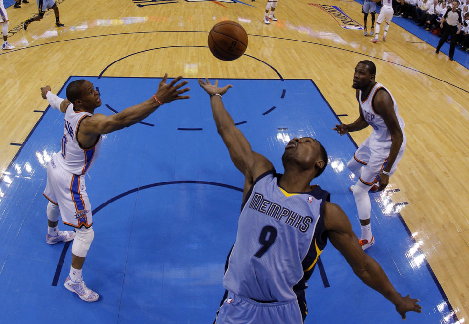 Photo - Memphis' Tony Allen (9) shoots a lay up as Oklahoma City's Russell Westbrook (0) defends during Game 2 in the first round of the NBA playoffs between the Oklahoma City Thunder and the Memphis Grizzlies at Chesapeake Energy Arena in Oklahoma City, Monday, April 21, 2014. Photo by Sarah Phipps, The Oklahoman