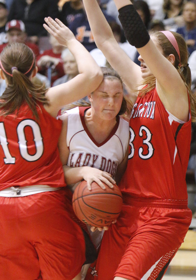 Photo - Washington's #10 Allison Wells and #33 Kelsey Johnson put the squeeze on Spiro's   Brianna Brooks during the Class 3A Girls quarterfinal basketball game at Southern Nazarene University's Sawyer Center in Bethany, OK, Thursday, March 13, 2014,  Photo by Paul Hellstern, The Oklahoman
