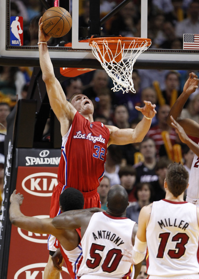 Photo - Los Angeles Clippers forward Blake Griffin (32) dunks the ball against the Miami Heat during the first half of an NBA basketball game, Sunday, Feb. 6, 2011, in Miami. (AP Photo/Wilfredo Lee)