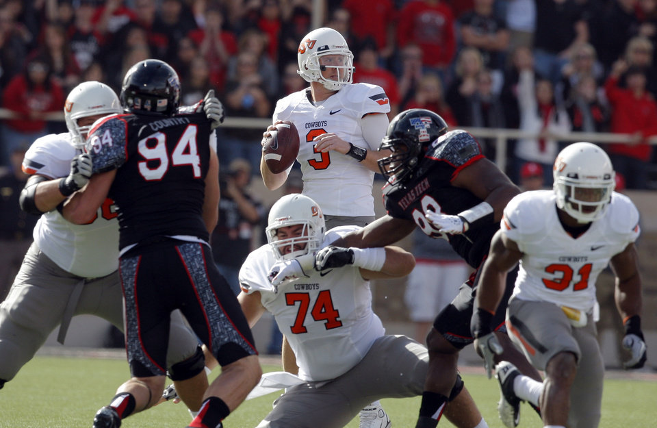 Oklahoma State's Brandon Weeden (3) looks to pass during a college football game between Texas Tech University (TTU) and Oklahoma State University (OSU) at Jones AT&T Stadium in Lubbock, Texas, Saturday, Nov. 12, 2011.  Photo by Sarah Phipps, The Oklahoman  ORG XMIT: KOD