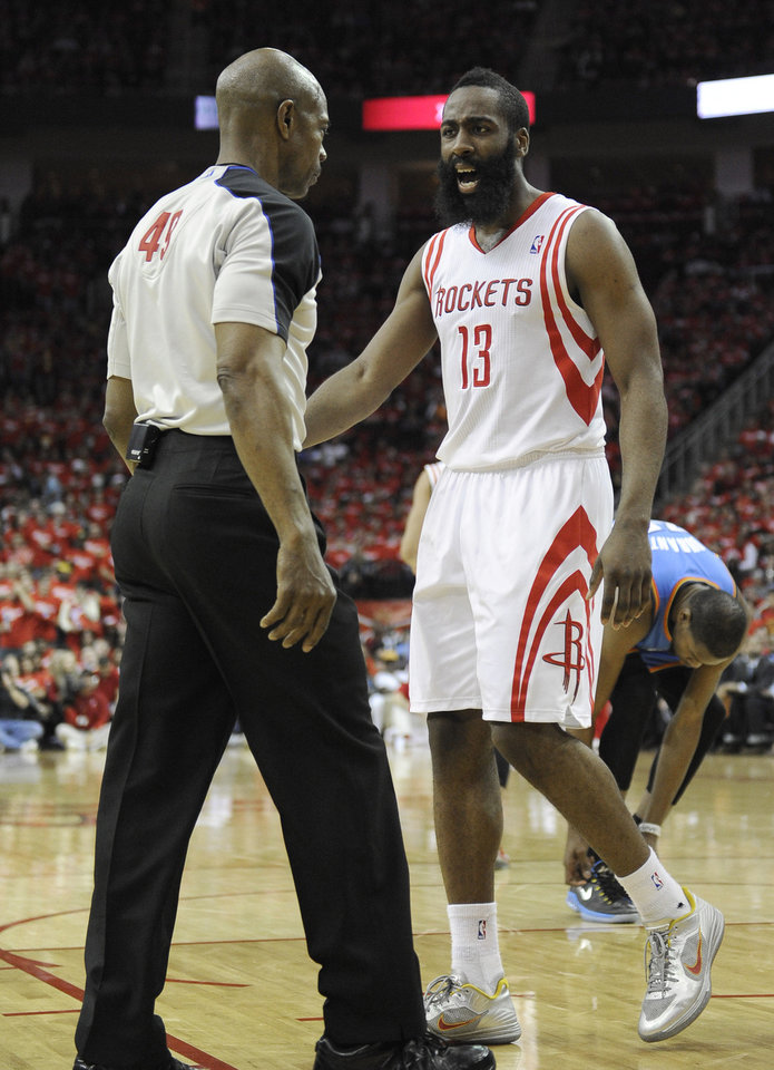 Photo - Houston Rockets' James Harden has words with referee Tom Washington in the second quarter of Game 6 in a first-round NBA basketball playoff series against the Oklahoma City Thunder, Friday, May 3, 2013, in Houston. (AP Photo/Pat Sullivan)