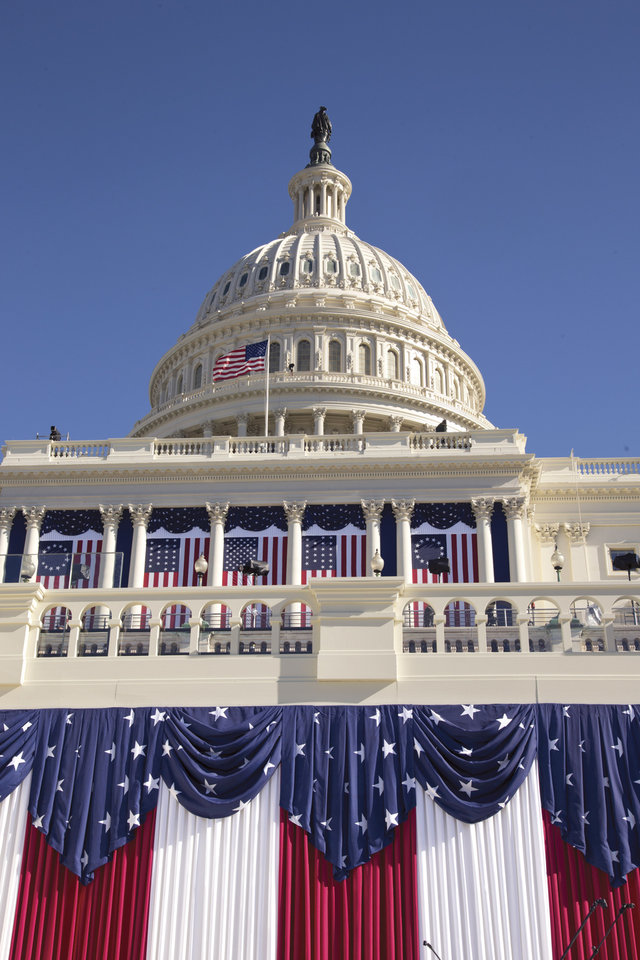 The West Front of the Capitol in Washington, is dressed in red, white and blue before the 57th Presidential Inauguration and President Barack Obama's second inauguration, Saturday, Jan. 19, 2013. (AP Photo/J. Scott Applewhite)