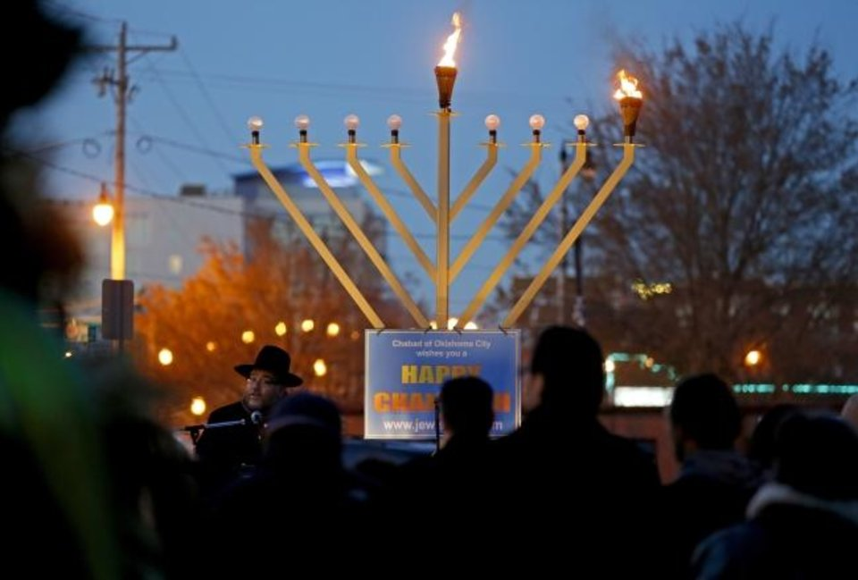Photo -  Rabbi Ovadia Goldman, spiritual leader of the Chabad Community Center for Jewish Life and Learning, addresses a crowd during the 2013 Bricktown Menorah Lighting event in Oklahoma CIty. [Bryan Terry/The Oklahoman]