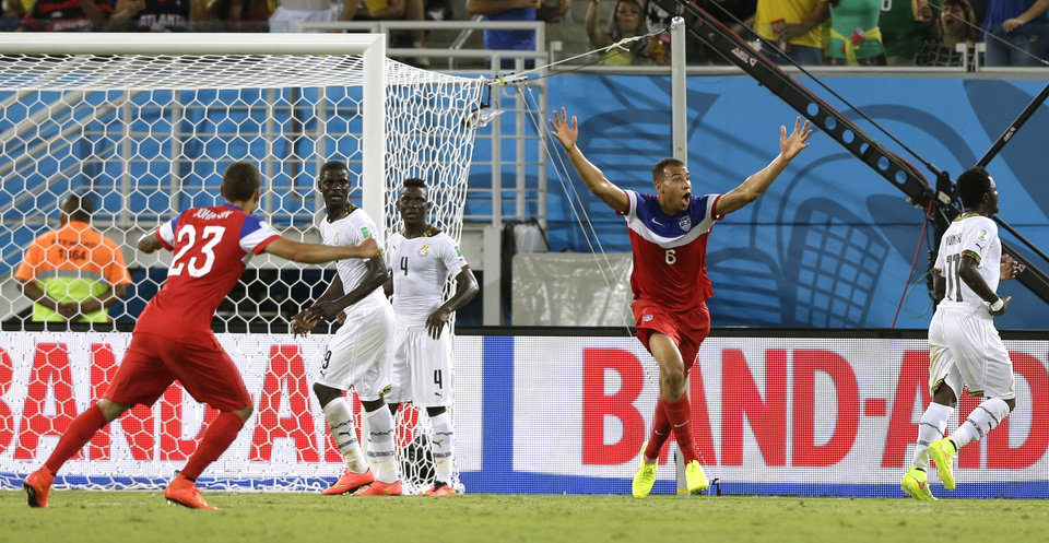 Photo - United States' John Brooks, second right, celebrates after scoring his side's second goal during the group G World Cup soccer match between Ghana and the United States at the Arena das Dunas in Natal, Brazil, Monday, June 16, 2014.   (AP Photo/Dolores Ochoa)