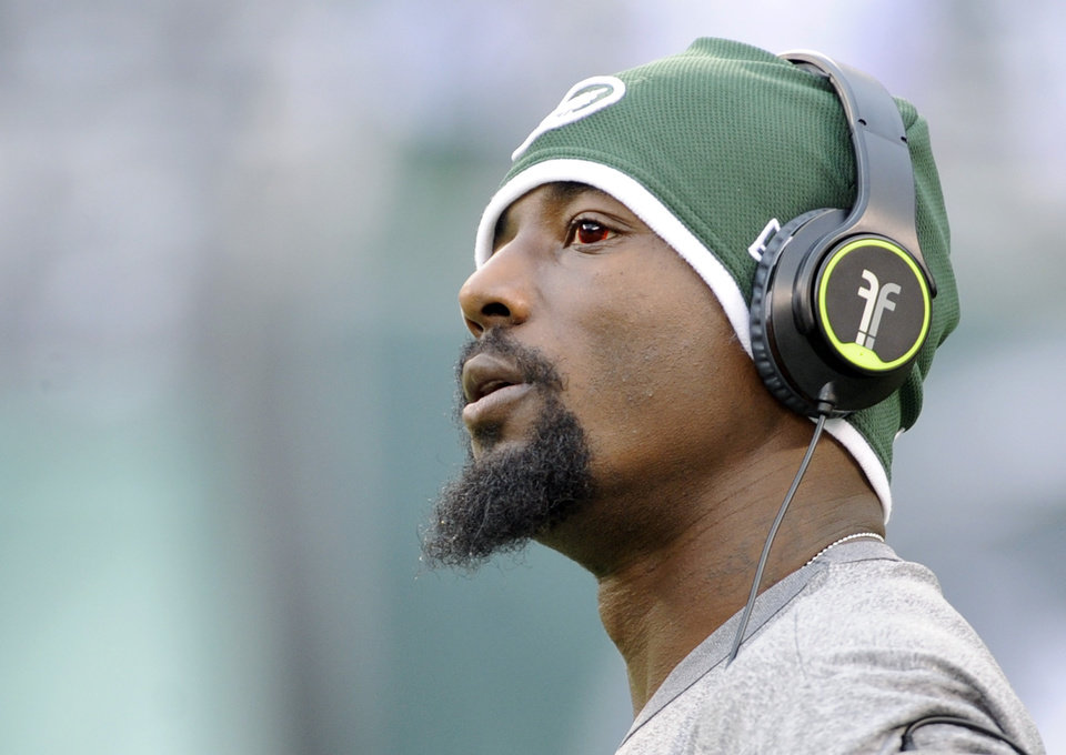 Photo - FILE - In this Dec. 22, 2013 file photo, New York Jets wide receiver Santonio Holmes looks on before an NFL football game against the Clevelnad Browns, in East Rutherford, N.J. The Jets have parted ways with Holmes, cutting the talented but injury-plagued playmaker after four seasons. The move Monday, March 10, 2014, which had been expected, saves the Jets $8.25 million, which Holmes was due to make as his base salary this season.  (AP Photo/Bill Kostroun, File)
