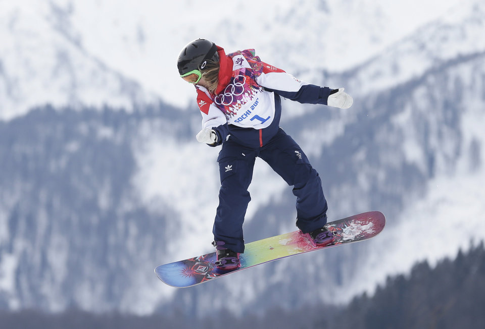 Photo - Britain's Jenny Jones jumps during the women's snowboard slopestyle semifinal at the 2014 Winter Olympics, Sunday, Feb. 9, 2014, in Krasnaya Polyana, Russia. (AP Photo/Andy Wong)