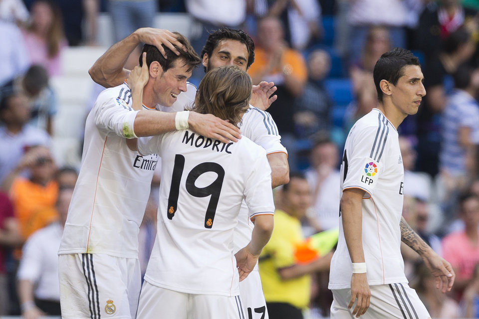 Photo - Real Madrid's Gareth Bale from Wales, left, celebrates his goal with teammates Luka Modric from Croatia, and Arbeloa during a Spanish La Liga soccer match between Real Madrid and Espanyol at the Santiago Bernabeu stadium  in Madrid, Spain, Saturday, May 17, 2014. (AP Photo/Daniel Ochoa de Olza)