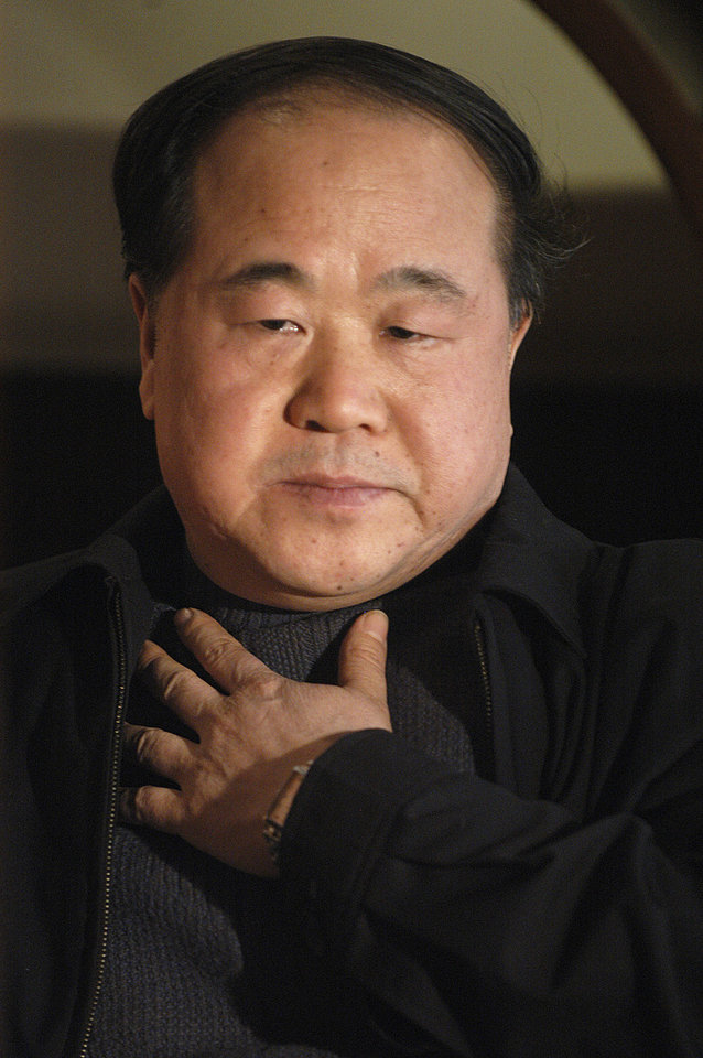 Photo -   In this photo taken Tuesday, Dec. 27, 2005, Chinese writer Mo Yan listens during an interview in Beijing. Mo won the Nobel Prize in literature on Thursday, Oct. 11, 2012. (AP Photo) CHINA OUT